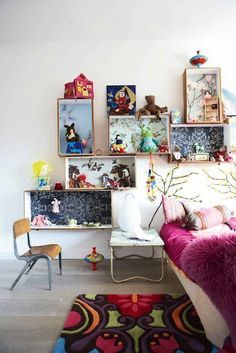 Recycle old wooden crates or boxes and hang them on your child's bedroom walls to hold toys, books, and other accessories. You can give them new life by painting or wallpapering them. From Love Chic Living More Kid-Friendly Decorating Tips: 5 Commandments for Kid-Friendly Decorating 8 Ways to Create Your Family's Dream Kitchen 10 Family-Friendly Decorating Tips You Didn't Know   - HouseBeautiful.com