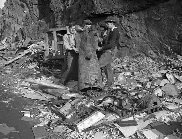 Damage to the Scotia Pier caused by a torpedo fired by the German submarine U-518 on 2 November 1942. Bell Island, Newfoundland, 3 November 1942.