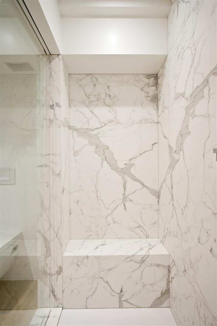 white calacatta marble bathroom by belgian interior