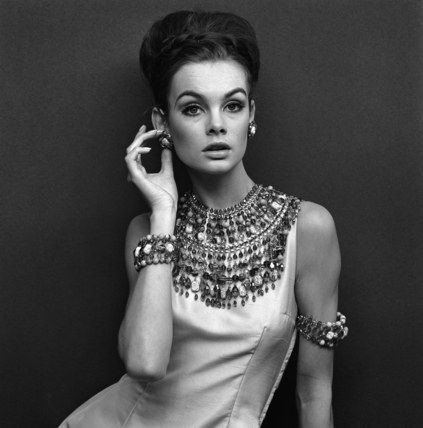 jean shripmton in some very middle eastern inspired bling and coin charm bracelets. really awesome vintage look