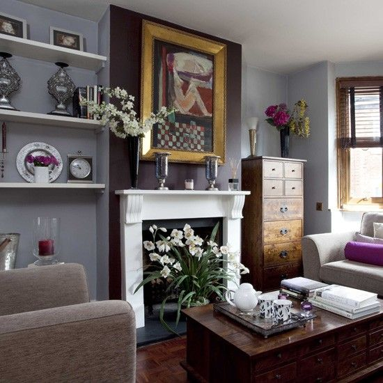 Grey living room with white fireplace Chestnut furniture set against slate grey walls gives this living room a traditional feel with a sophisticated edge. Shots of hot pink add vibrancy to the scheme.   Sofa Marks & Spencer Coffee table Laura Ashley  Read more at http://www.housetohome.co.uk/room-idea/picture/traditional-living-room-ideas-10-of-the-best-1/3#adYw9Q31mr3kyxDH.99