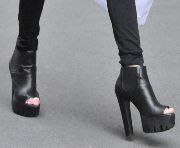 Allegra Versace's Thin Frame Makes Her Platform Booties Stand Out
