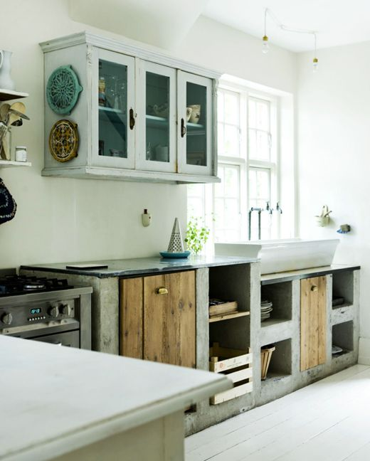 Concrete Cabinets, Wood Plank Doors, Farm Style Vessel Sink? 1000 times yes.