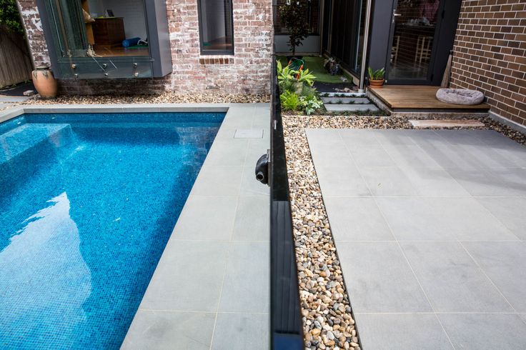 """Nulla Bluestone otherwise known as """"volcanic stone"""" pavers are generally considered to be strong, dense, durable and stain resistant, perfect for the pool just like in this photo which was installed for a local client. Visit our website to learn the various characteristics of each stone and receive individual assistance in choosing just the right product to beautify your home and garden http://ow.ly/Z4jo309He73"""