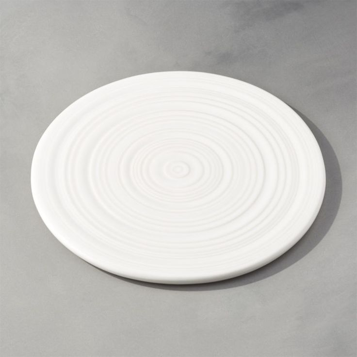 Shop Farmhouse Trivet. Made in Portugal by skilled artisans, this trivet ribbed with concentric circles was inspired by traditional techniques but made with modern technology.