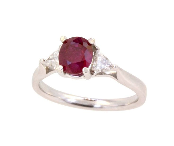 This beautiful ring is 18k white gold with an eye catching 1.24ct ruby. With two trillion cut diamonds on either side, with a total carat weight of 0.23, this would sparkle like fire on the finger of your July woman. www.gembycarati.com  www.facebook.com/gembycarati