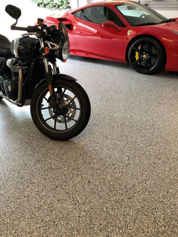 Does Your Garage Floor Get Cracks Holes Grease Stains And Tire Tracks No Worries Because We Offer Two Soluti Epoxy Floor Concrete Decor Refinishing Floors