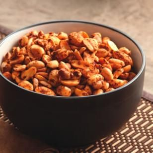 Celebrating Cinco de Mayo?  Make this traditional Mexican street treat - Chile Lime Peanuts.  It's just regular salted peanuts, lime juice, chili powder, and cayenne pepper.  Bake on a cookie sheet in a 250 degree oven for about 45 min, stirring every 15 min.  They are just delicious with margaritas or beer. Mmmmm.