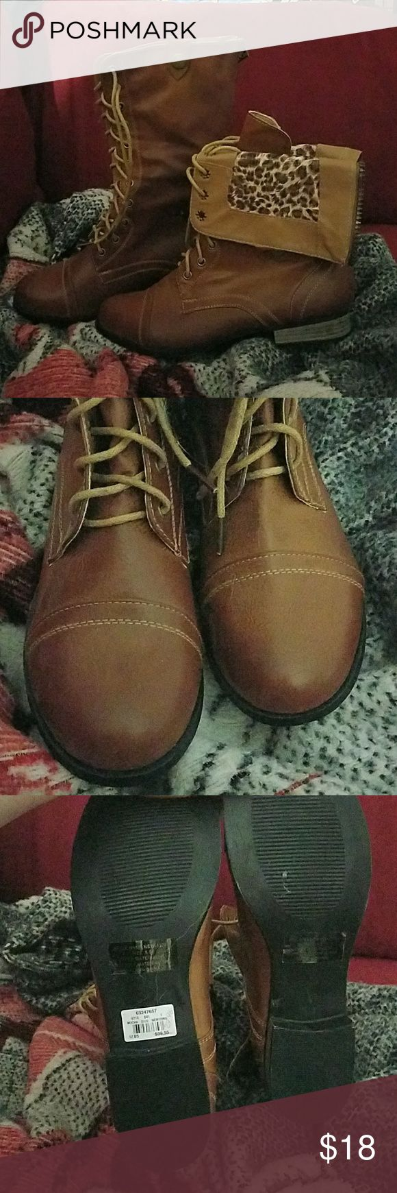 NWT tan leather boots with cheetah zip down inset! Vanity brand Tan leather boots with cheetah inset that can be flipped down for another look. New with tags still on never worn. Make an offer. Tag shows marked down price so that's what I'm using! Vanity Shoes Combat & Moto Boots