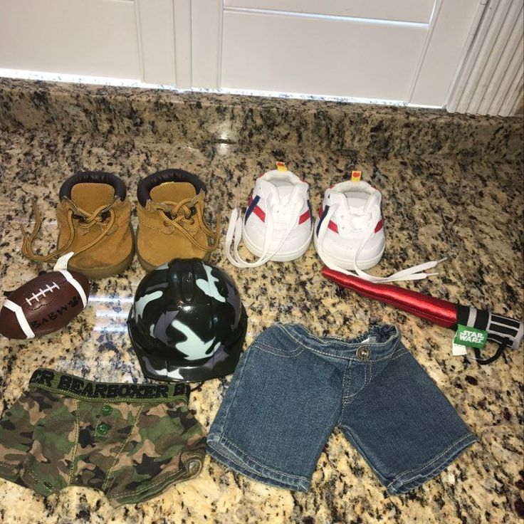 Preowned. BUILD A BEAR ACCESSORIES AND ITEMS INCLUDING ARMY HELMET, BUILD A BEAR FOOTBALL, BUILD A BEAR STAR WARS LIGHT UP LIGHT SABER, BUILD A BEAR ARMY BOXER BRIEFS UNDERWEAR AND JEANS, BUILD A BEAR SNEAKERS AND BOOTS.