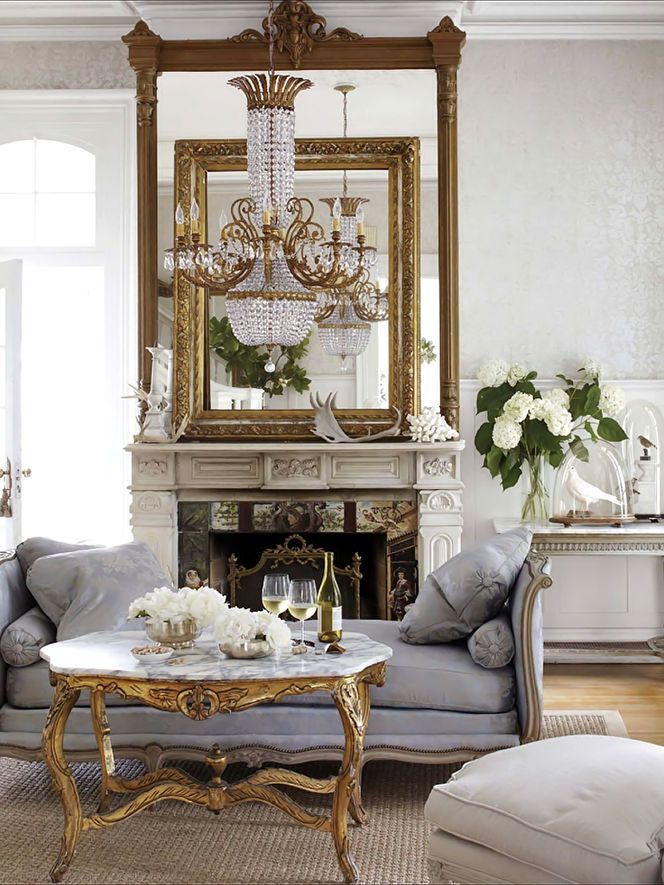 French style living room: grey and gold palette accented with glass & mirrors