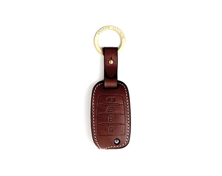 KIA 4 button folding Handmade Buttero Leather Smart Key Cover/Case   -Handmade by: Custom Republic  -Leather: Vegetable leather from Conceria Walpier & Vera Pelle -Attachment pieces: 18K gold satin coating - Colors: natural, yellow, orange, brown, navy, and camouflage -Thread & Stitching: Serafil (from Germany)  -Measurement: 4.3cm x 15cm