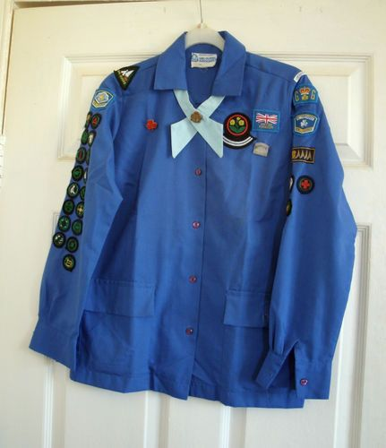 1970s UK Vintage Girl Guide Uniform | eBay  This Guide had done a lot of work. She's been to Our Chalet in Switzerland, got her Camp Permit, Homecraft and Service Emblems and her service flash. That's quite a haul!