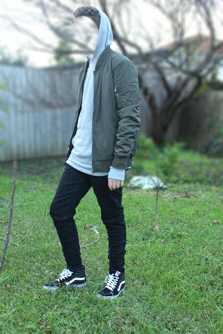 Army green bomber jacket, light gray pullover hoodie, black tapered jeans, black and white sk8-his.