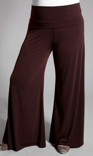 An easy-going wide-leg pant, breezy and chic. These plus size palazzo pants are so comfortable, you will marvel at how easily they pair with dressy tops and heels. Equally chic with an embroidered tank, casual tee, and sandals. Wide waistband can be rolled over to sit right at the hips or kept unfolded for tummy support-- These are something i would like to add to my wardrobe... comfy and chic...