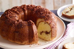 Moist Sour Cream Coffee Cake recipe - The sour cream in this cake batter helps make a tender moist cake, laced and topped with a sweet pecan, brown sugar and cinnamon streusel.