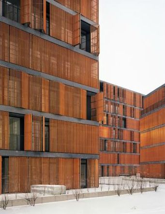 "Wilanowska Housing Complex by JEMS Architekci, Warszawa, Poland 2009. External facades are formed in a harmonious, restrained and uniform manner in their ""grid"" structure, with large, evenly spaced horizontal openings.  In order to enhance the intimate ambience of the apartments, movable wooden louvers are provided to a substantial part of the facades, which, alternately open or closed, form a delicate, vibrating structure."