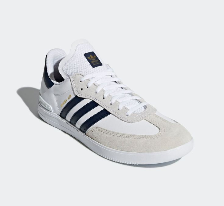 Samba ADV trainers in footwear white with collegiate navy trim. The ADV is  primarily a