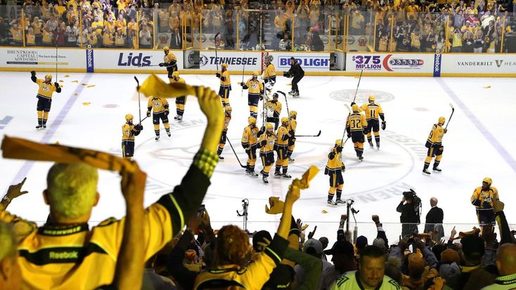 Nashville, TN - June 5: Fans cheer as the Nashville Predators celebrate defeating the Pittsburgh Penguins with a score of 4 to 1 in Game Four of the 2017 NHL Stanley Cup Final at the Bridgestone Arena on June 5, 2017 in Nashville, Tennessee.