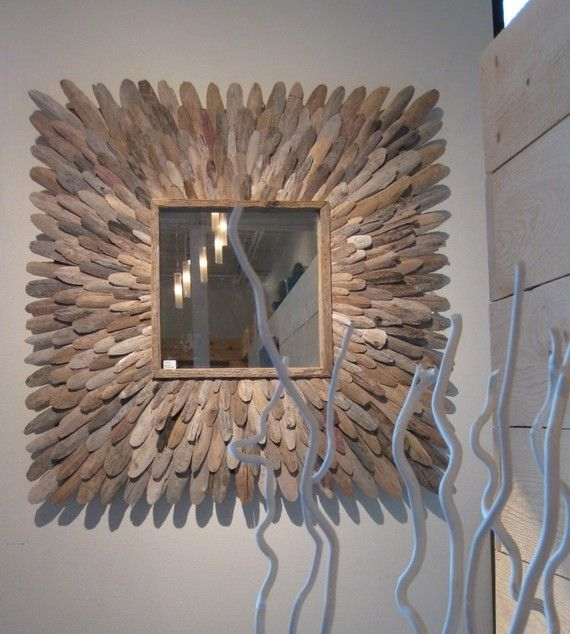 This mirror is 42 square and about 2 off the wall. The mirror space itself is 18 x 18 the mirror is not included. It is made from slices of Michigan driftwood. Custom sizes available. I make them to order once theyve been purchased. It usually takes me about three weeks before I can ship it out. If you are in a hurry let me know and Ill do my best.
