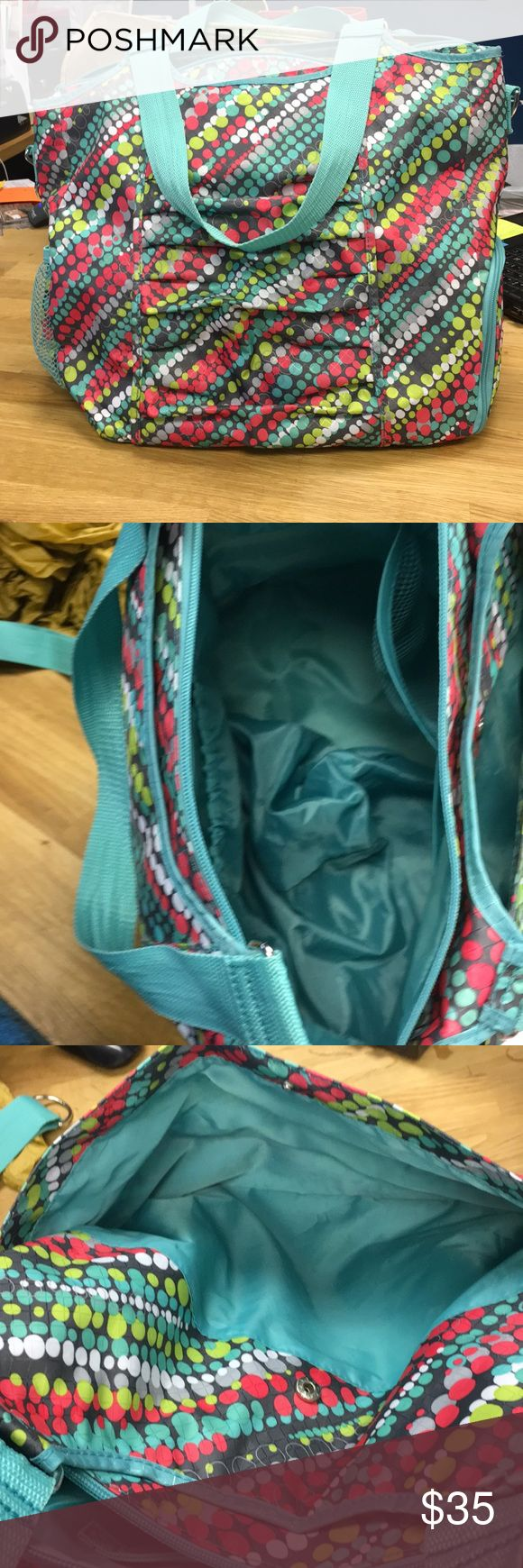 Thirty One Yoga Bag EUC From April 2014. This amazing bag has pockets for everything. Side pouch for your shoes! A front sleeve for your yoga mat! No visible wear. Excellent condition. All zippers functional. thirty one Bags Totes