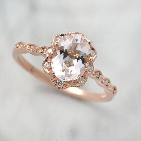 The ring is in 14kt. Pink Gold with an 8 x 6 ( 2.00carats). Natural Oval Morganite set in 14 karat gold with 14 fine white brilliant diamonds (1.15mm) and they weigh .11 carats and are graded G in color and SI1 in clarity. Also a very special 15th diamond is set under the intricate halo basket in this stunning design. This ring can be ordered in different metals and comes in many finger sizes. The shadow band can be ordered separately in different metals and will cost $ 265.00. https:/&...