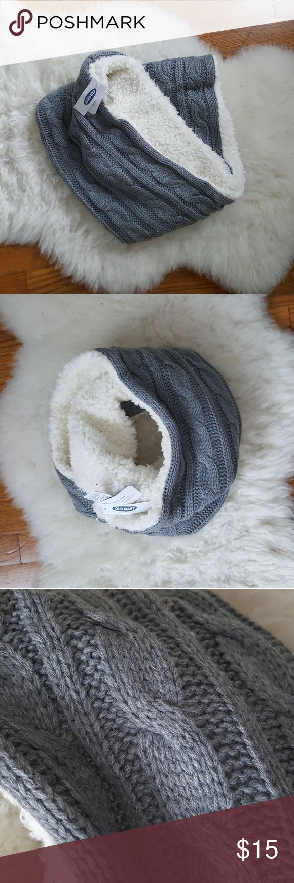 NWT Old Navy grey faux-fur lined infinity scarf Super soft faux fur lines this grey cable knit infinity scarf - makes it nice and warm. I have too many scarves, otherwise I'd keep this one! Old Navy Accessories Scarves & Wraps