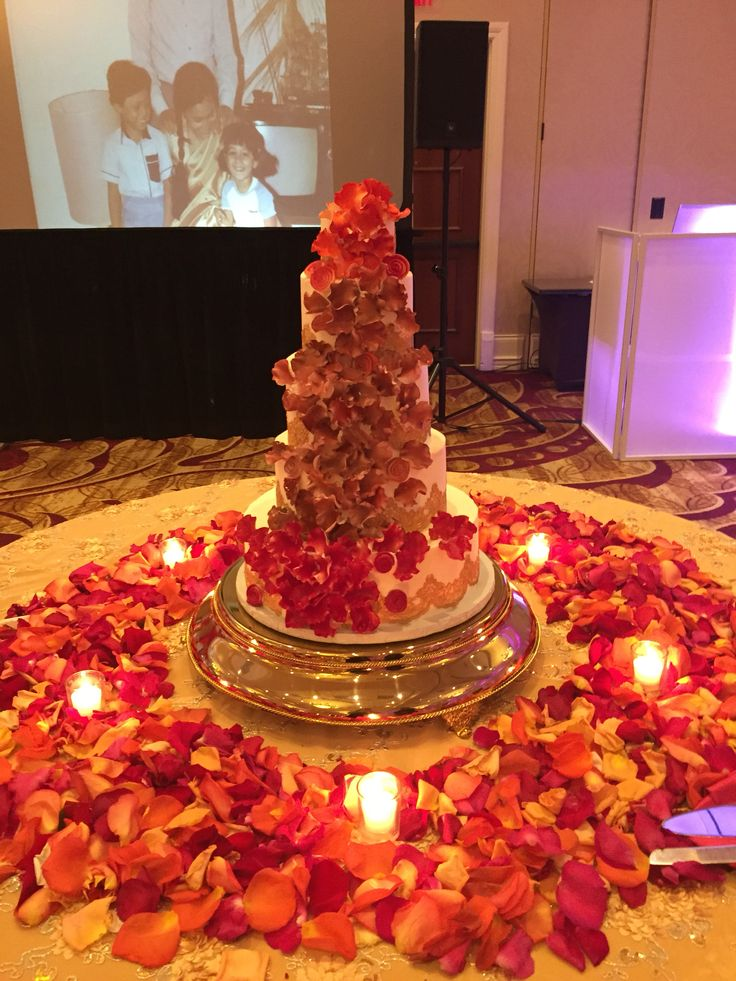 Gold Lace Indian Wedding Cake With Flower Petals Colored Fuchsia Burnt Orange And Deep Red