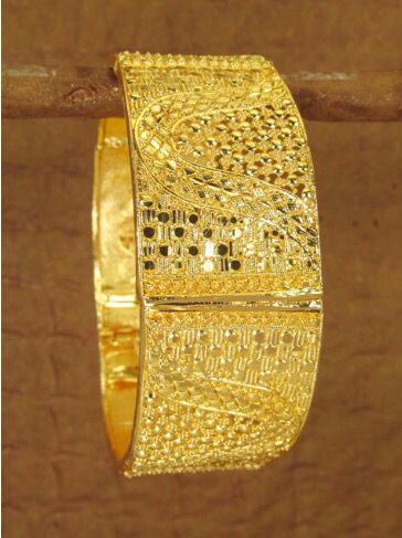 A beautiful gold bracelet with amazing handcrafted detail.