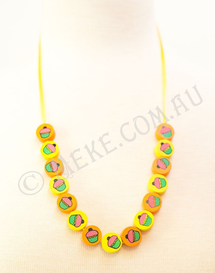 : : Sunshine and Cupcakes Necklace : :  Your little cupcake will look adorable in this handcrafted children's necklace featuring bright sunshine yellow and sunrise orange timber cupcake beads on a matching bright yellow ribbon. Too cute!!!  Visit my Etsy store for more info, or to purchase: https://www.etsy.com/au/listing/153870961/sunshine-and-cupcakes-childrens-necklace?ref=related-1  Handmade with love and care by Marianne ❤