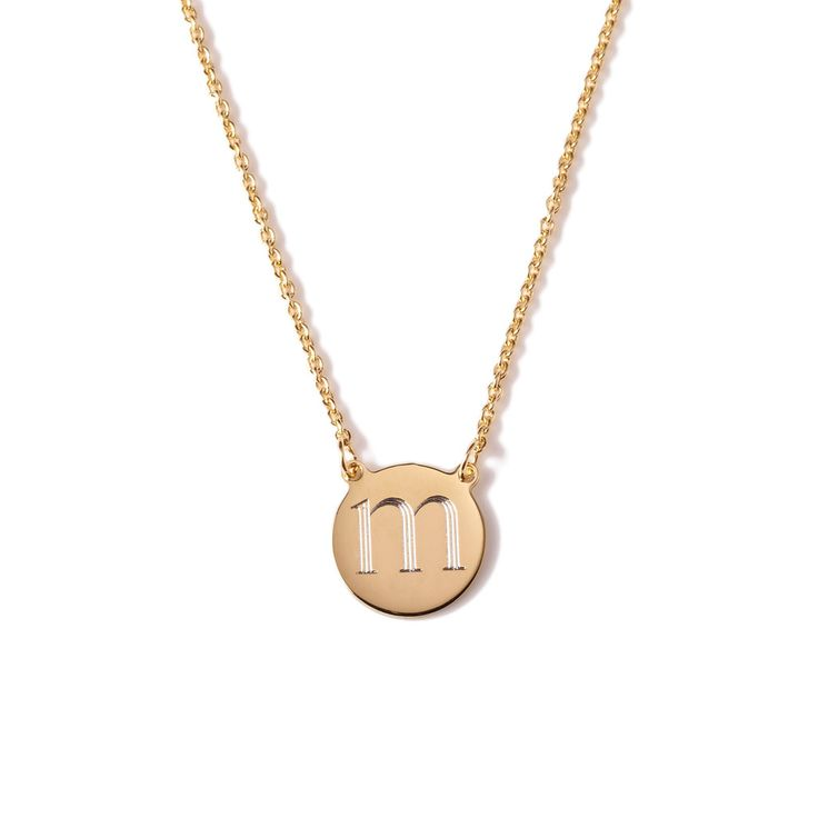 Perfectly sized to fit a single initial, this delicate round charm necklace looks just as great layered with other equally dainty pieces as it does worn solo.