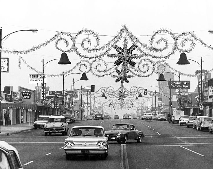 This is a Christmastime view looking east along Magnolia Boulevard in Burbank (ca. 1961). The cross street in the foreground is North Cordova Street, and the Art Moderne California Theater is visible in the right background. Anyone remember Yonan's Restaurant at 3700 West Magnolia Boulevard at Hollywood Way, about a block behind the camera?