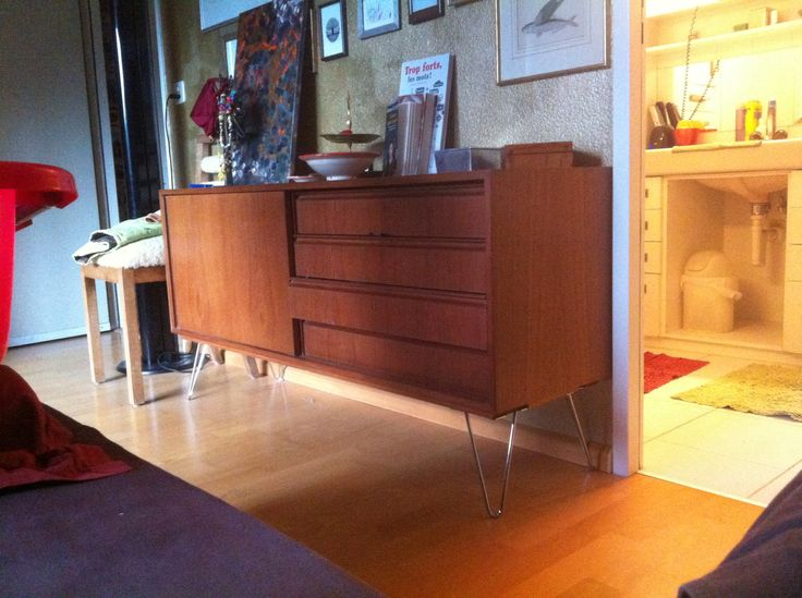 Grandma's sideboard revamped with chromed wire legs.