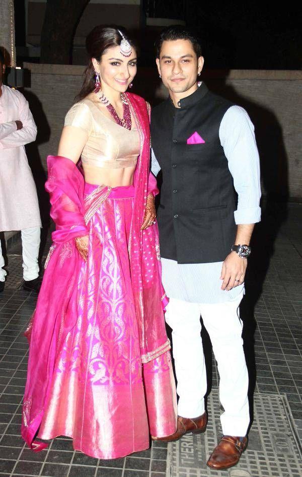 Soha Ali Khan & Kunal Kemmu pose at their Wedding Reception, Jan 25, 2015 Soha's Hot Pink & Gold Lehenga is by Sanjay Garg http://www.RawMango.in/