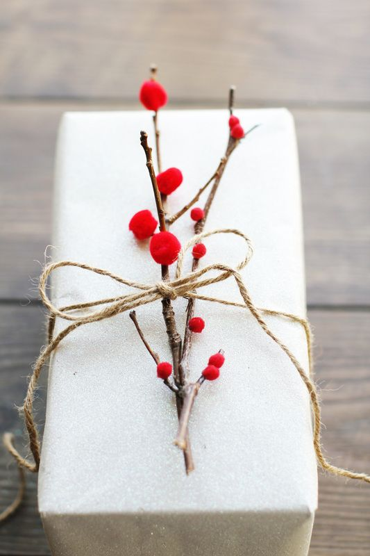 red pom poms on a twig for an easy gift topper // #christmas #DIY