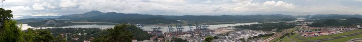 Pacific entrance of the Panama Canal with the Pacific Ocean and Puente de las Americas (Bridge of Pan-American Highway) at the left and Miraflores locks at the far-right [10557  1248]