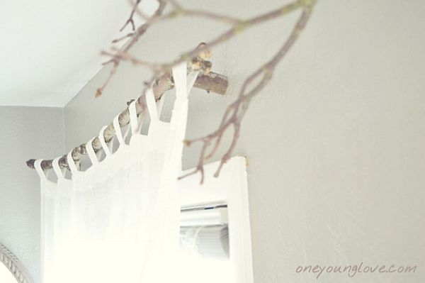 Stunning. Homemade drapery hardware from tree branches!