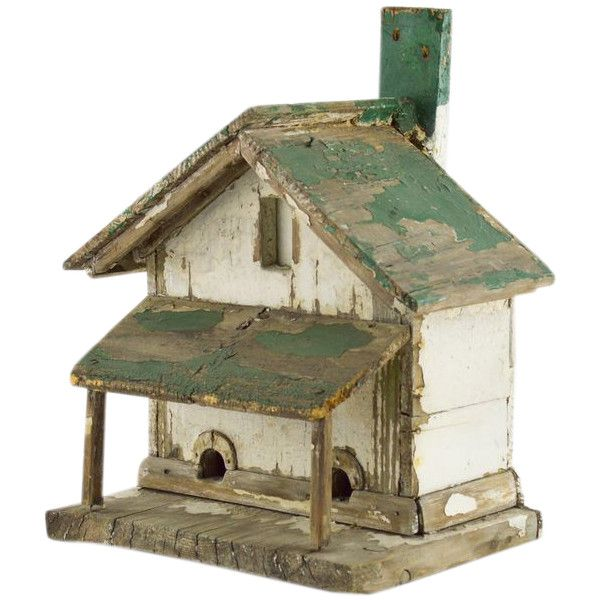 An interesting weathered, painted wooden bird house. Rustic, primitive, and old - it's a bit of folk art and a nice decorative item. 13 x 11 x 17