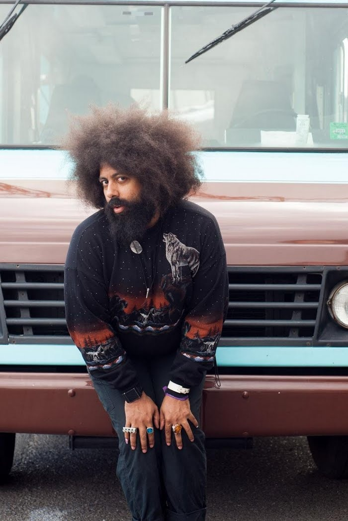 Reggie Watts photographed by Chona Kasinger. Reggie, you and that wolf sweater are freaking adorable.