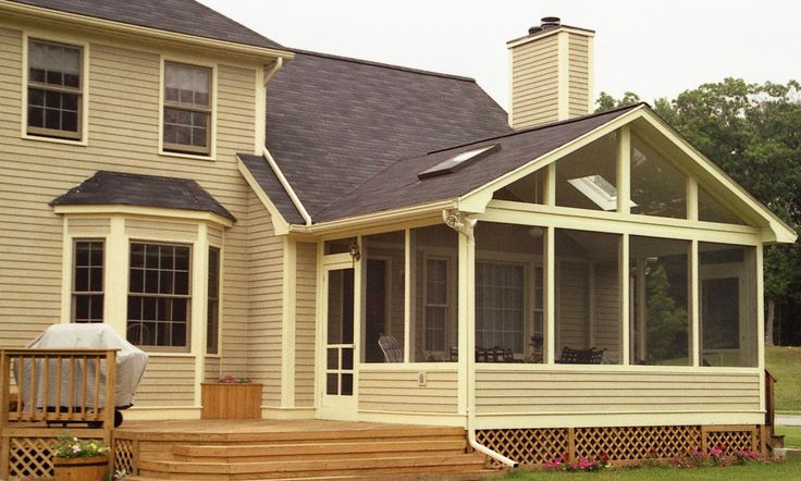 Screened Porch With Knee Wall in Chapel Hill. I love this classic screened porch and deck combination. The color of the deck and the siding makes a nice neutral place to relax that fits in seamlessly with the house. With a planter box built right in, I can put my spring annuals in and then pop some mums in there in October. The door leading to the screened in porch looks like a fun take on the classic slamming screen door from when I was a kid. #screenedporchideas
