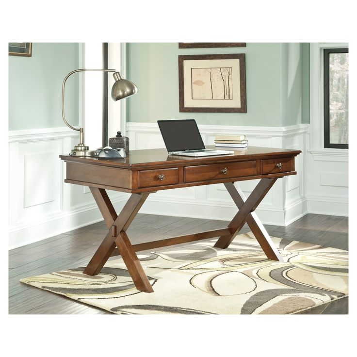 This desk stands right at the intersection of work and pleasure. Work surface is perfectly poised atop an X-shape trestle base. Two drawers on each side and a pull-out keyboard tray concealed behind the center drawer keep everything organized and on task. Signature Design by Ashley is a registered trademark of Ashley Furniture Industries, Inc.