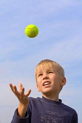 throwing a tennis ball into a bucket from horseback