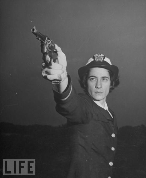 October 1,1943 | A WAVE Takes Target Practice  The 90,000 members of the U.S. Navy's WAVES (Woman Accepted for Volunteer Emergency Service) would serve only on the home front, but they would still get marksmanship training.