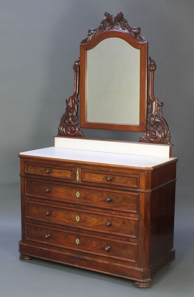 Lot 998, A French 19th Century wash stand with arched plate mirror and white veined marble top above 2 short and 3 long drawers with tore handles, raised on bun feet est £150-200