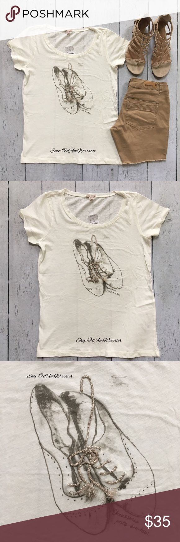 """🆕NWT J.Crew embroidered Oxford shoe t-shirt So cute I can't even handle this! Cream/ivory soft cotton shirt sleeve t-shirt with taupe/tan graphic print of ladies oxford lace up shoes. The laces in the shoes is actually metallic embroidery. Also has written in French 'Good looking shoes'! Size large, but could easily accommodate a medium. Please use provided measurements as a guide. Approximate unstretched measurements laying flat are: 26"""" long, 18.5"""" across bust. Please read bio regarding…"""