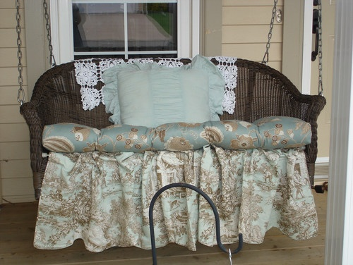 Restyled Home - eclectic - porch. Great upcycle old wicker into a porch swing. Paint white and add the skirt, easy