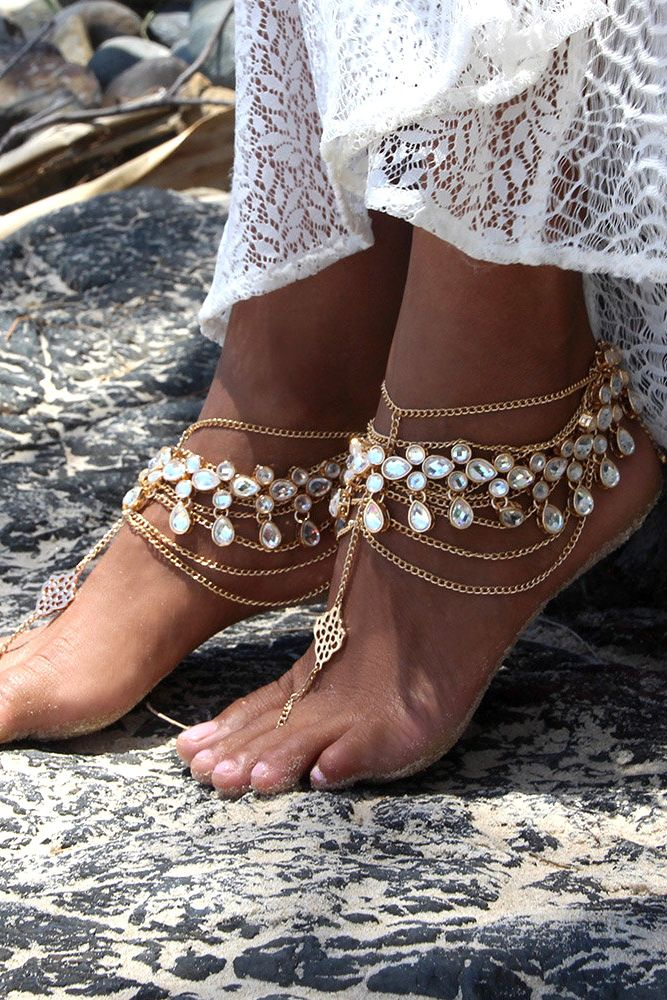 Look chic with sandy feet. These barefoot sandals bring glamour to a beach wedding.