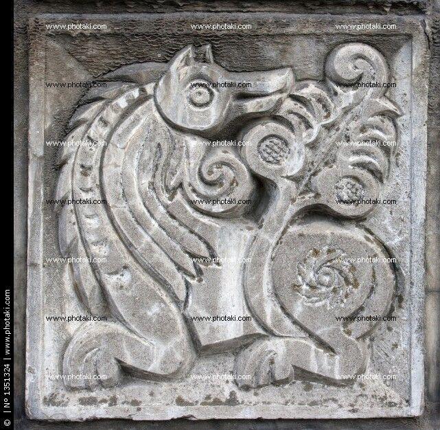 Dropbox - oude-bas-relief-van-sprookjesachtige-fantasie-wolf-op-de-muur_1351324.jpg