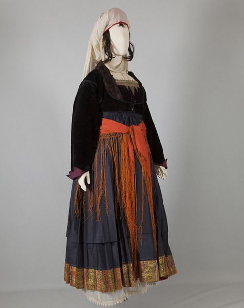 Women's costume of Psara, North-East Aegean Islands. Early 20th c. ©Peloponnesian Folklore Foundation, Nafplion, Greece. Women's costume of Psara belongs to a type that appears to have been worn in varying forms on other Aegean islands too. It is renowned for its silk tsiboukotó chemise. The sleeveless dress has a pleated skirt with the characteristic horizontal pleat. This pleat is found in nearly all island-type dresses. The headdress with its silk bólia is also typical of island costumes.