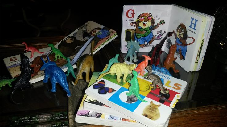 November 2, 2014: We went to his grandparents' house for an overnight stay and the dinosaurs got into his favourite books! Son's fave part was that the dinos were standing on the books. (?? haha)